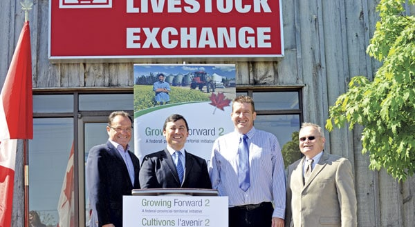 MPs Harold Albrecht and Michael Chong were joined by livestock transportation stakeholders including CAWC executive director Mark Beaven and Canada Mink Breeders Association executive director Gary Hazlewood. [Scott Barber / The Observer]