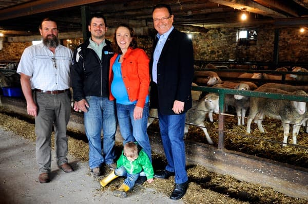 Ryan and Romy Schill showed off their sheep farm to CSF vice-chair Rob Scott (left) and Kitchener-Conestoga MP Harold Albrecht (right), along with the help of their sons Cameron and Emerson (middle).[Whitney Neilson / The Observer]