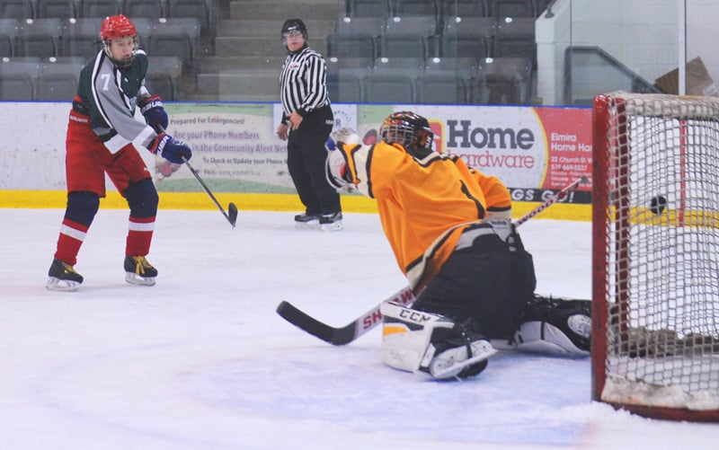 The EDSS boys' hockey team defeated Forest Heights Collegiate Institute 5-3 on Dec. 1 in Elmira. Here, Cade Schaus scores for Elmira.[Whitney Neilson / The Observer]