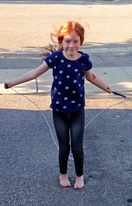 Mia O'Malley McLachlan couldn't be more pleased with her new artificial arm from War Amps that lets her skip and play on monkey bars, among a host of other options.[Submitted]