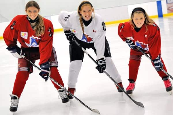 """Hannah Petrosino, Jenna Duimering and Taylor Schmitt were among 150 female Ontario hockey players who laced up for the """"Long Game"""" in Mississauga on Oct.11.[Whitney Neilson / The Observer]"""