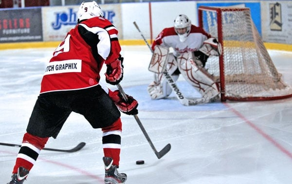 Reid Denstedt eyes the goal during the Wellesley Applejacks' 3-2 victory over the Norwich Merchants Oct. 11 at the Wellesley arena.