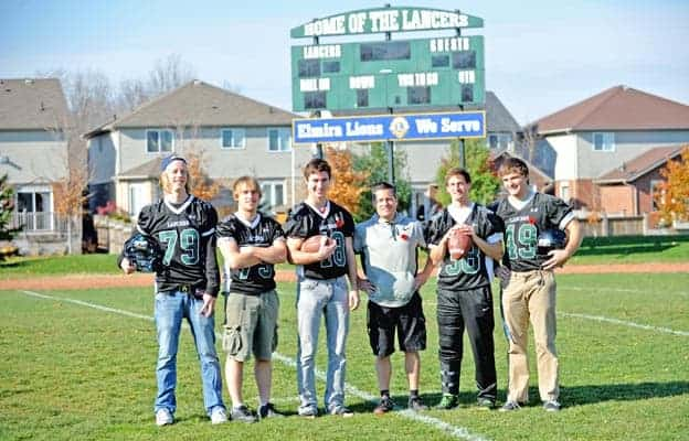 Wesley Wickers, Adam Cook, Alex White, coach Steve Karn, Jordan Frey and Alex Weber were key members of the Elmira District Secondary School senior football squad, which posted a 5-1 regular season record before falling in the WCSSAA quarter-finals.[Scott Barber / The Observer]