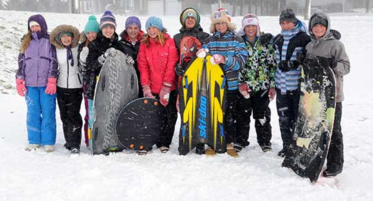 Students in Wellesley took advantage of a snow day on Nov. 18, sledding behind the St. Clements Arena. From left, Jade Lipczynski, Nikki Beam, Jessie Herbison, Olivia Bolender, Taylor Hartung, Abbey Brick, Lucas Economides, Nolan Hislop, Jake Voisin, Zac Good, and Liam Dietrich.[Whitney Neilson / the observer]