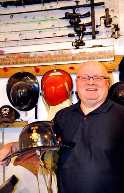 Joe Kelly keeps a collection of firefighter gear compiled during his 35 year career as a volunteer with the Elmira fire station. [Scott Barber / The Observer]