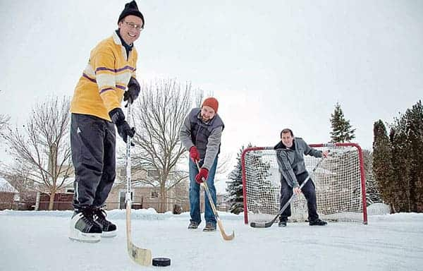 Robert McLeman, Colin Robertson, and Haydn Lawrence test out a backyard rink, which can be added to the map on RinkWatch.[Submitted]