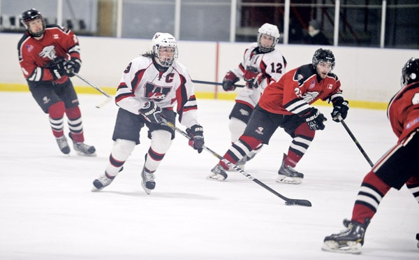 Captain Reid Denstedt carries the puck in Wednesday's game, which saw the Jacks' highest output with four goals. It wasn't enough, however, as they were swept by the Ayr Centennials in the first round of the playoffs.[Whitney Neilson / The Observer]