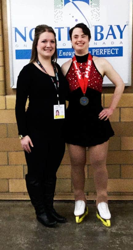 Coach Jess Somerville and Natalie Stevanus with her gold medal.[Submitted]