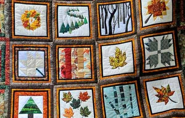 Crafted by numerous members of the Woolwich community including a number of Old Order Mennonites, the Trees for Woolwich quilt will be up for auction during Woolwich Healthy Communities Month events in April and May. [Scott Barber / The Observer]