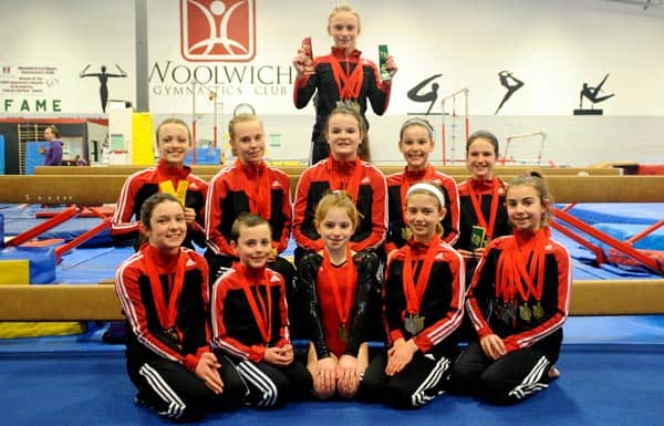 The Woolwich Gymnastics Club's competitive team brought home nearly 40 top-three medals from the Lightning by the Falls Competition. Front row: Aurora Rueffer, Welcome Gilbert, Jordyn Kelly, Alex Kirkup, Julia Ersil. Middle row: Trinity Barnes, Allison Saulesleja, Mackenzie Simpson, Kennedy Bradley, Tegan Krieger. Back row: Makenna Heibein. [Whitney Neilson / The Observer]