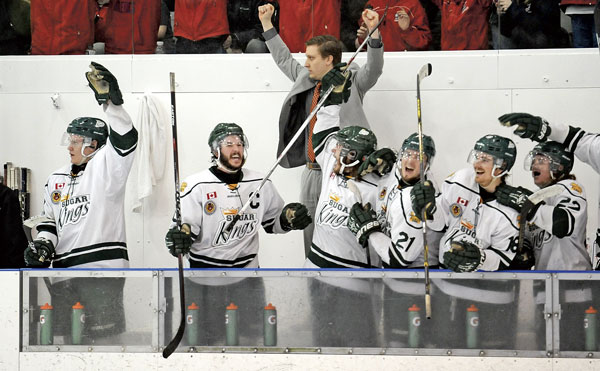 The home bench celebrates following Ethan Skinner's third goal of the game, which sealed the deal at 5-1 with less than a minute remaining. [Scott Barber / The Observer]
