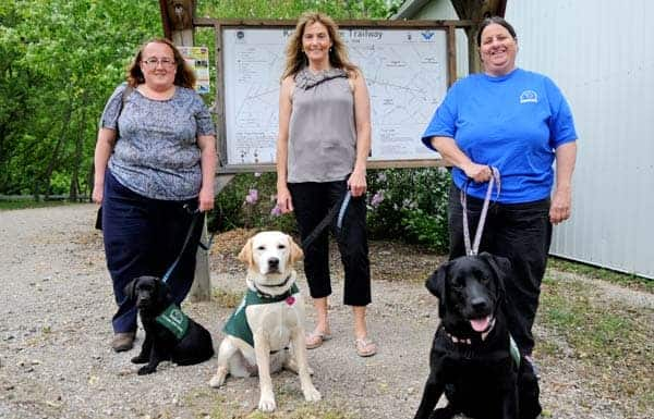 The annual Purina Walk for Dog Guides takes to the trails in Elmira this Sunday to raise funds for the Lions Foundation dog guides, with participants like Nancy Chiasson, Blue, Cheryl Bauman, Quix, Deb Cserhalmi and Hedwig.[Whitney Neilson / The Observer]