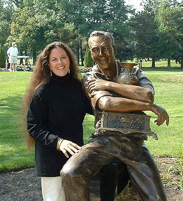 Ruth Abernathy stands beside her sculpture of Arnold Palmer. [Submitted]
