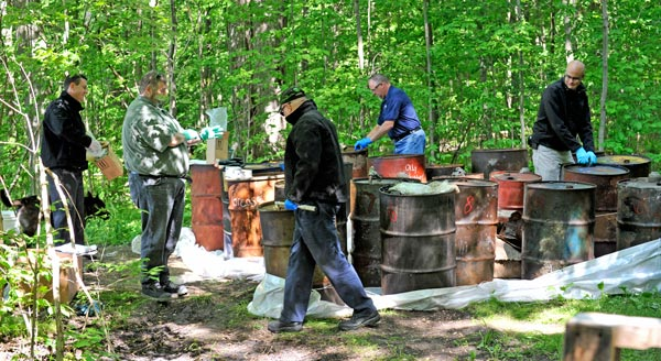 Safety-Kleen and Waste Management have teamed up to dispose of the two dozen barrels of hazardous waste illegally dumped in the sugar bush at 1189 Weeby Pl. near Conestogo last month.   [Scott Barber / The Observer]