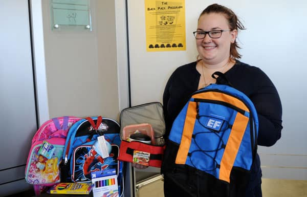 Summer student Megan Andrews is busy helping Woolwich Community Services collect supplies for their annual backpack program. [Whitney Neilson / The Observer]