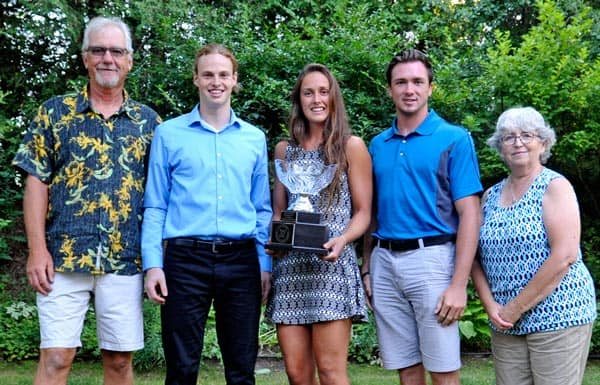 This year's Dan Snyder Memorial Scholarship recipients Matthew Leger, Marlowe Schott and Mitch Wright were flanked by Graham and Lu Anne Snyder Wednesday evening during an awards presentation in Waterloo. [Scott Barber / The Observer]