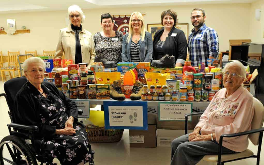 Residents at Chartwell Elmira/Chateau Gardens gathered to present their donated food and $871 for the Woolwich Food Bank's Thanksgiving Drive. Back row: Joan Norris, Vicky Rau, Kelly Christie, Mandy Holmes, and Matthew Bombardier. Front row: Metilda Gingrich and Susannah Martin.[Whitney Neilson / The Observer]