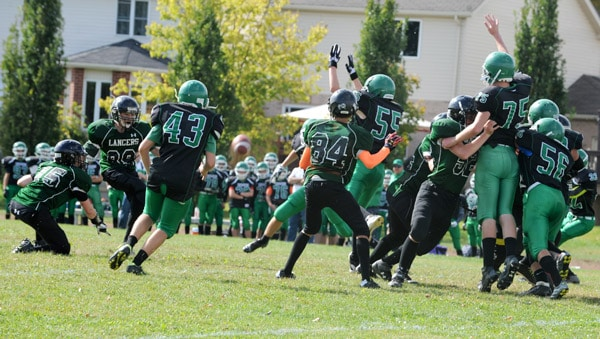 The EDSS junior boys' football team emerged victorious in the Battle of the Barns Oct. 8, handing Waterloo-Oxford a 16-3 loss.[Whitney Neilson / The Observer]