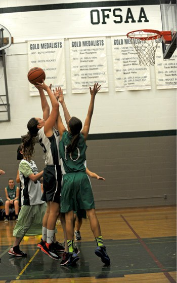 Natalie Mayer reaches up to make the shot as the junior team takes on Waterloo-Oxford Oct. 8, ultimately falling 47-25.[Whitney Neilson / The Observer]