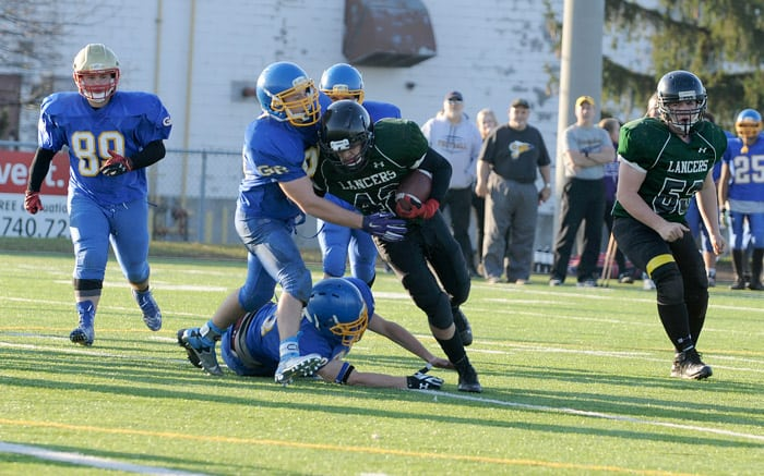Tyson Palmer moved the play up field as the EDSS junior football team defeated Grand River Collegiate Institute 7-0.