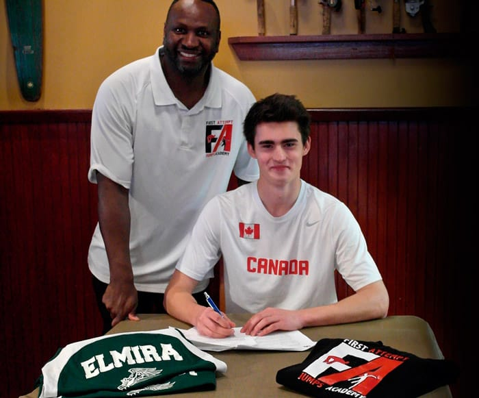 EDSS student Nathaniel Mechler signs his scholarship contract with the University of Houston at a signing party in Guelph as his coach, Dermott Smith from First Attempts Jumps Academy, looks on. Mechler will be going to Houston in the fall to pursue a degree in kinesiology and to train for the 2020 Olympics.[Submitted]