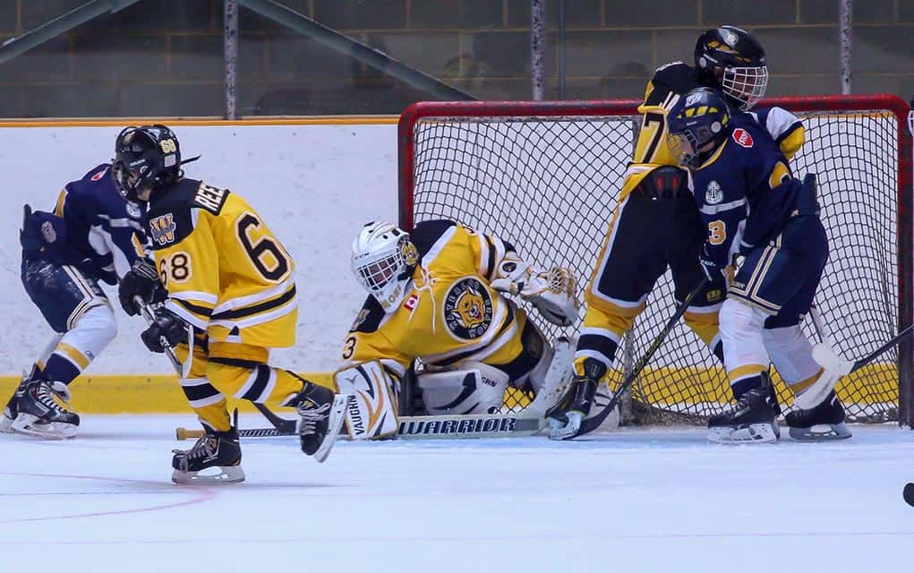 Waterloo Wolves goalie Mitch Simmons makes a save as Nolan Reesor and Aaron Jain watch. The Waterloo Wolves were in Kitchener last week for the annual Oktoberfest Tournament.