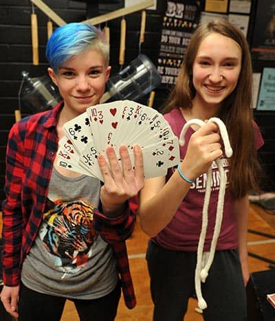 Naomi Jenzen and Savanah Campbell, Grade 11 students at Elmira District Secondary School, are practicing for their upcoming magic show, open to the public on Jan. 21 at 6:30 p.m. Abracadabra![Liz Bevan / The Observer]
