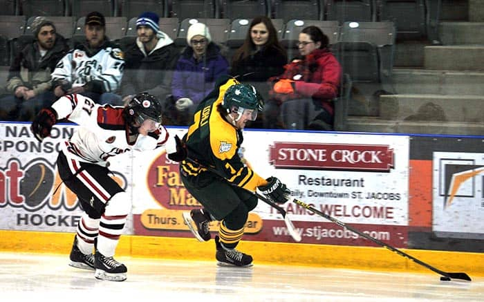 Elmira Sugar Kings captain Rob Kohli keeps the puck away from the Brantford 99ers on Sunday night at Dan Snyder Arena. The Kings skated to a convincing 6-0 victory.[Liz Bevan / The Observer]