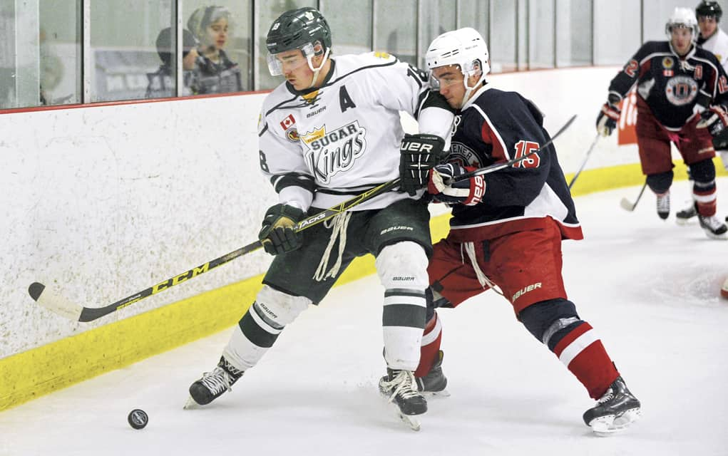 Sugar King Zac Coulter and Dutchman Ryan George battle for the puck in Tuesday night's close 3-2 win for Kitchener over Elmira at the Kinsmen Arena.[Whitney Neilson / The Observer]