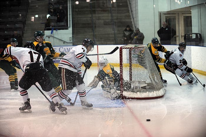 Jonathan Reinhart's net gets knocked off as some Cambridge Winter Hawks attempt to score during game action Sunday at the WMC. The Elmira Sugar Kings won 5-3.[Whitney Neilson / The Observer]