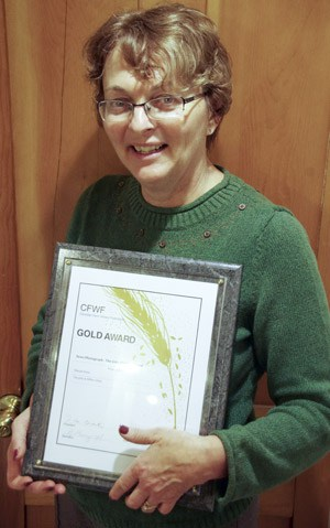 Sharon Grose with her CFWC award in Calgary. [Submitted]