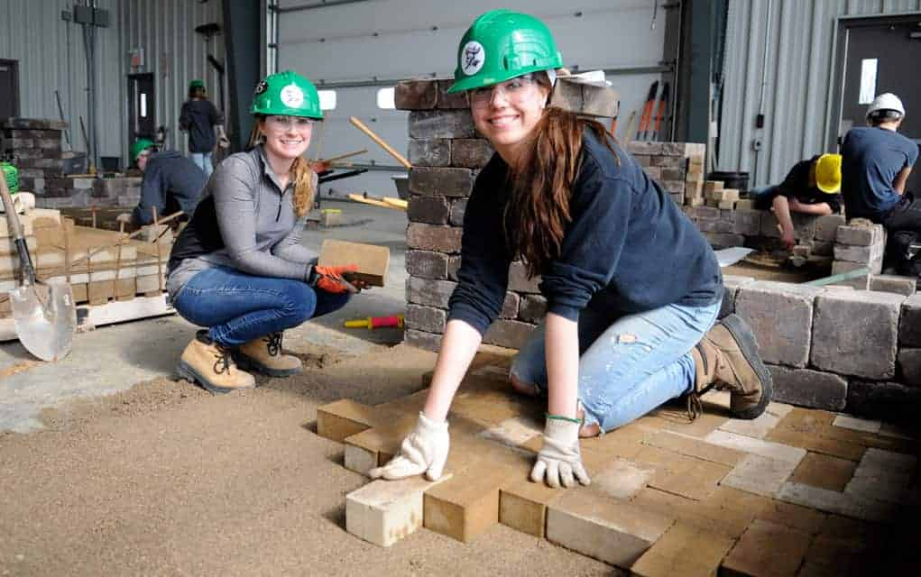 EDSS students Shawntanna Atkinson and Sadie Richmond get their hands dirty at the regional Skills Canada competition in Elmira on Mar.8. Finishing in second-place, the students were one of two teams from the high school competing for a spot at provincials.[Liz Bevan / The Observer]