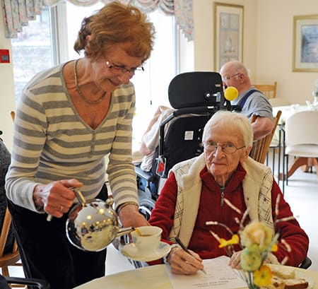 The Elmira Chartwell Retirement Residence gathered for a worldwide tea part on Mar. 16 in an attempt to break the Guinness World Record for largest multi-site tea party in conjunction with other healthcare facilities around the world. Here, Betty Ertel serves tea to Birthe Falk.[Whitney Neilson / The Observer]