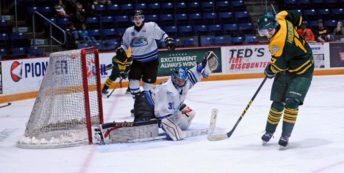 Klayton Hoelscher scores in the Sugar Kings' 4-1 Game 5 win over the Guelph Hurricanes on Mar. 12, clinching the series and moving on to the semi-finals versus Stratford starting on Friday.[Whitney Neilson / The Observer]