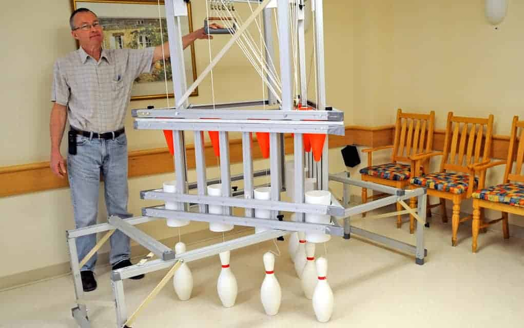 With ingenuity and reused parts, handmade pinsetter brings bowling to Elmira retirement home