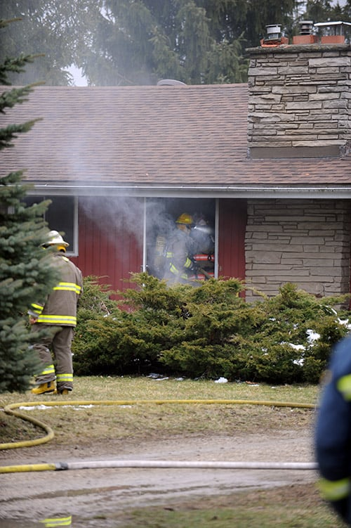 Fire crews from St. Jacobs and Conestogo were on scene at a house fire Apr. 7 on Country Squire Road. The fire was called in by a neighbour, a volunteer firefighter, just before 5 p.m.[Liz Bevan / The Observer]
