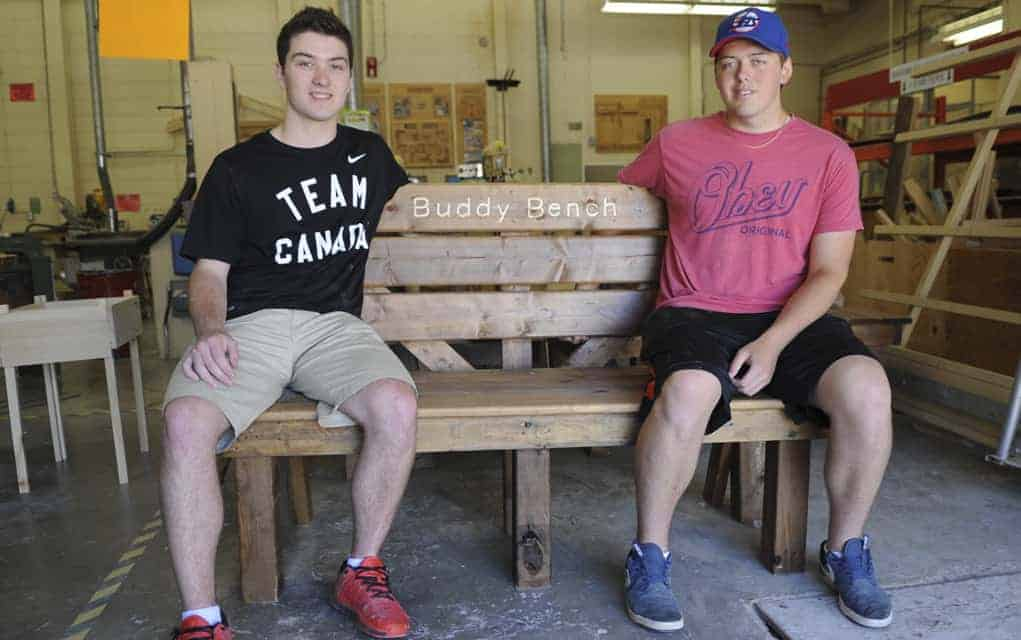 Students make benches that are designed to help shy kids get more involved