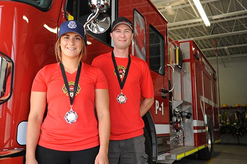 Wellesley volunteer firefighters Ryan Dosman and Madison Lavigne show off their medals from regional FireFit competitions. They are prepping for nationals in Calgary by competing at even more regional races.[Liz Bevan / The Observer]