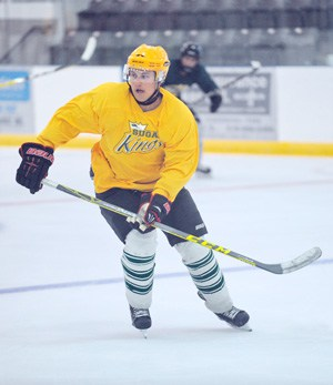 Klayton Hoelscher, returning from last year's lineup, skates his way to the puck during the Kings' weekend inter-squad scrimmages.[Liz Bevan/ The Observer]