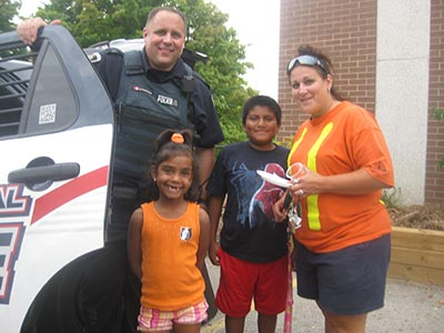 Constable Rabidoux with Ashrena, Pablo and Lesley Swift.