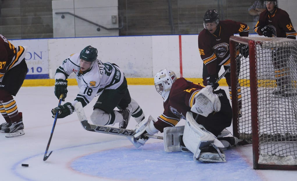 Keanan Stewart battles for the puck in front of the Brampton net during Sunday's game at the WMC.[Whitney Neilson / The Observer]