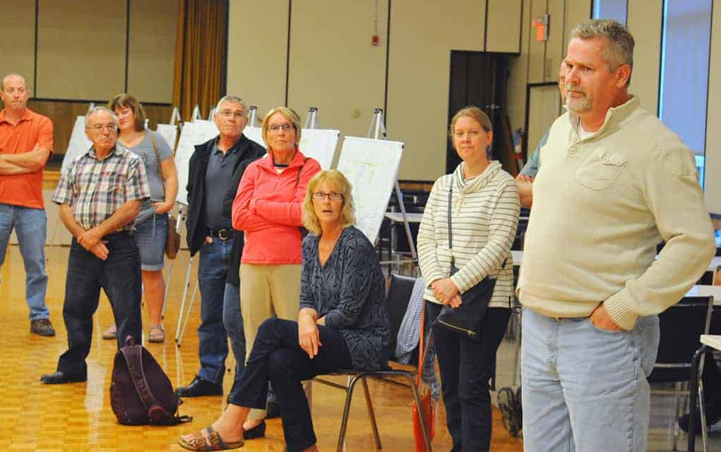 Rick Stroobosscher (right) was one of nearly 70 residents with a long list of questions at an information session in St. Jacobs.[Liz Bevan / The Observer]
