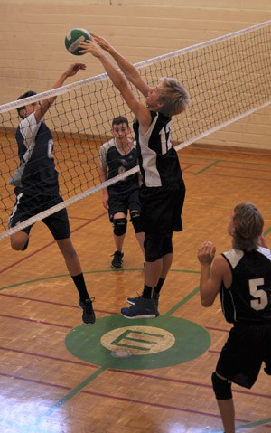 Stephan Wichers tips it over the net, the EDSS junior boys' volleyball team started strong this season with a 4-2 record. They narrowly beat Jacob Hespeler Secondary School 3-2 on Oct. 6 (25-16,11-25,12-25,25-21,15-13).[Whitney Neilson / The Observer]