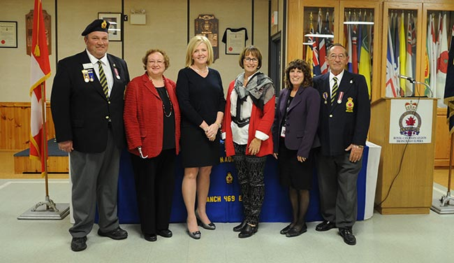 The Elmira branch of the Royal Canadian Legion handed out their four largest donations from last year's poppy fund last week to Grand River Hospital, St. Mary's General Hospital, Woolwich Township and Community Care Concepts. They gave back $31,192 to the community in total. From left, Elmira Legion president Joe Vervoot, Grand River Hospital Foundation president and CEO Tracey Bailey, St. Mary's General Hospital Foundation interim president Susan Dusick, Woolwich mayor Sandy Shantz, Community Care Concepts executive director Cathy Harrington and Elmira Legion poppy campaign chair Bill Strauss.[Whitney Neilson / The Observer]