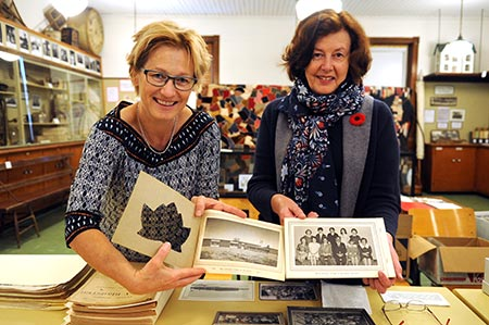 Margit Fritsch and Barb Nowak display some of the artifacts found in the Wellesley Historical Society archives while looking for additions to go in the community cookbook. Wellesley PS is celebrating their 50th anniversary and are on the hunt for recipes to put in the cookbook, celebrating the milestone anniversary for the school building. [Liz Bevan / The Observer]