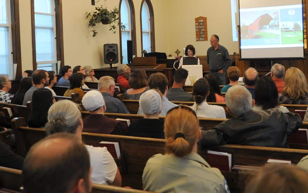 Residents call for improved communication at meeting to review June 23 flood