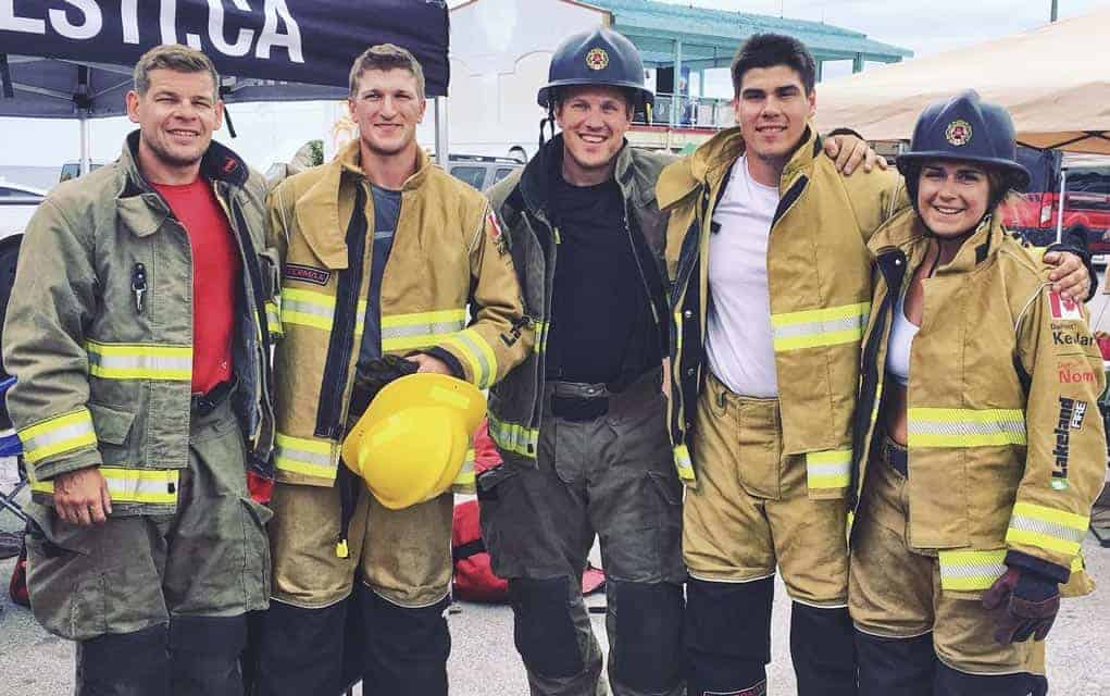 Dave Uberig, Wes Balfour, Steve Grein, Clayton Greer and Madison Lavigne following their relay completion at the FireFit competition in Wasaga Beach in early July.