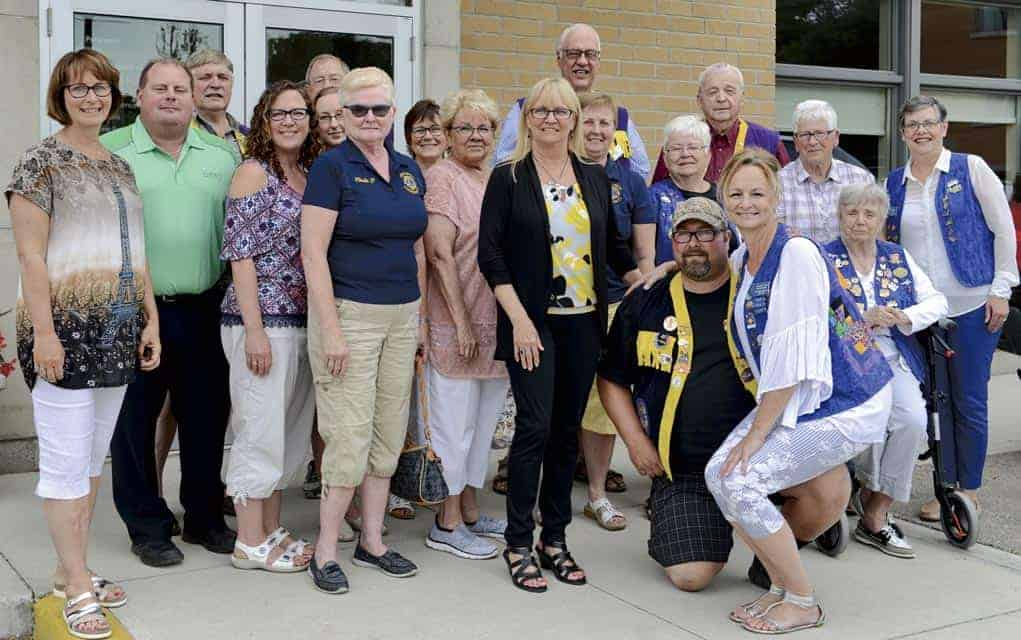Woolwich Mayor Sandy Shantz (left) joined members of both the Elmira Lions and Woolwich Community Lions clubs as well as the team at Woolwich Community Services on Wednesday as the service clubs presented their final donation to the WCS building campaign.