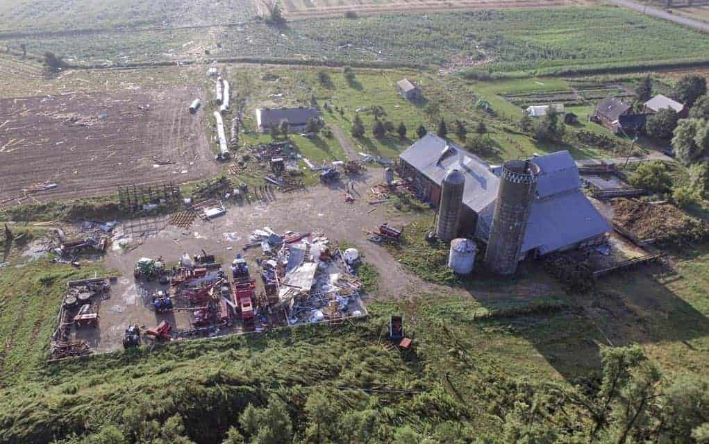 A photograph by an aerial drone of the Wideman property in Hawkesville, after the tornado struck. In the bottom left is the implement shed that was obliterated by the winds, with pieces of debris seen scattered across the fields. [Nate Leis / Submitted]