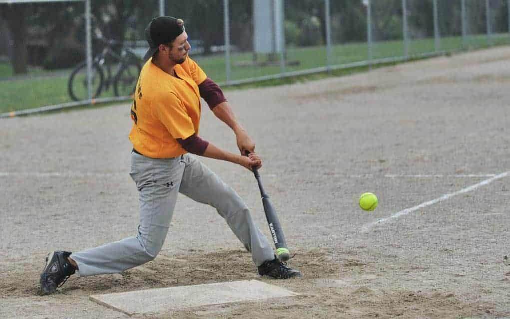 Don Green Memorial slo-pitch tourney spirit not dampened by rain